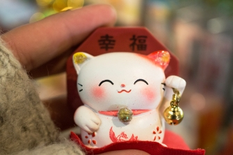 "Maneki-neko, meaning ""beckoning cat"", is a common Japanese figurine, said to bring good luck to the owner."