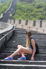 Taking a break on the Great Wall of China. There were two directions we could walk on the Wall, left (where it was extremely steep), and right (where the hike was easier). My family chose the steep side!